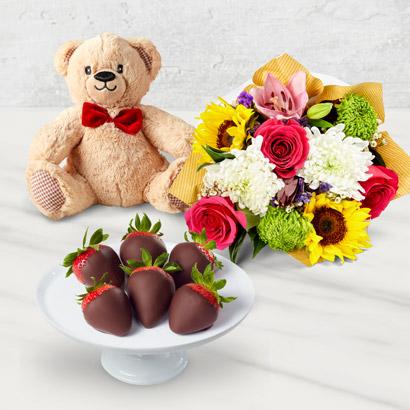 Bote cadeau de fleurs et de fraises enrobes de chocolat